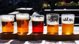 flight of partially drunk beers